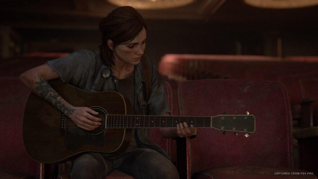 Ellie a tocar guitarra